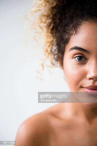 Portrait of Mixed Race woman with bare shoulders