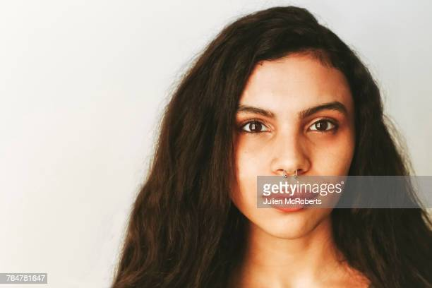 portrait of mixed race woman with nose ring - long nose stock photos and pictures