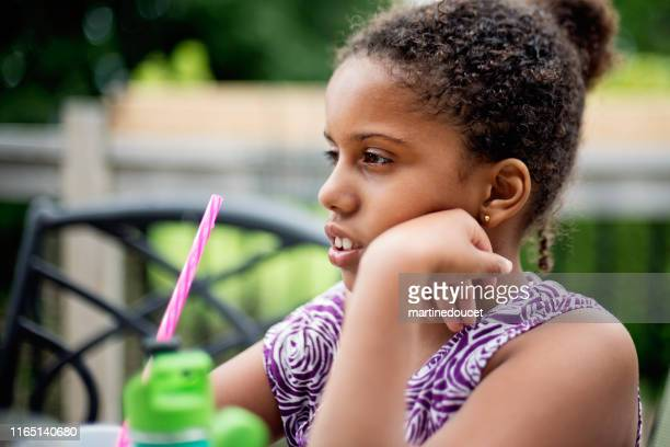 """portrait of mixed-race young girl with autism. - """"martine doucet"""" or martinedoucet stock pictures, royalty-free photos & images"""