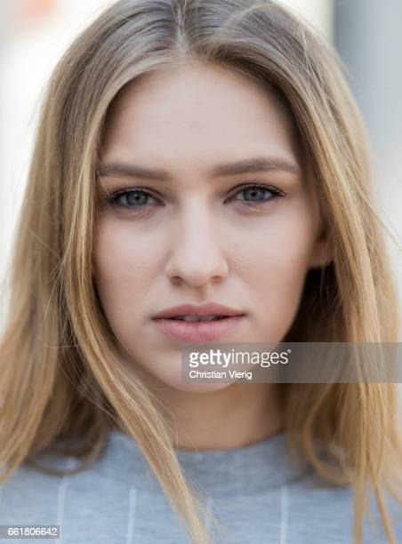 Portrait of model Adrianna Daniel wearing a grey track suit pants and sneakers Adidas Originals on March 31 2017 in Warsaw Poland