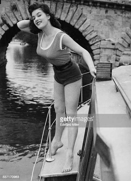 Portrait of model and actress June Wilkinson posing on a boat at a launch in Maidenhead England circa 1955