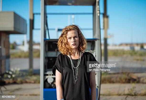 Portrait of model at abandoned gas station