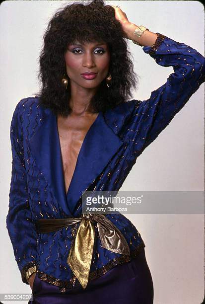 Portrait of model Beverly Johnson in a blue top with a gold belt New York 1980s