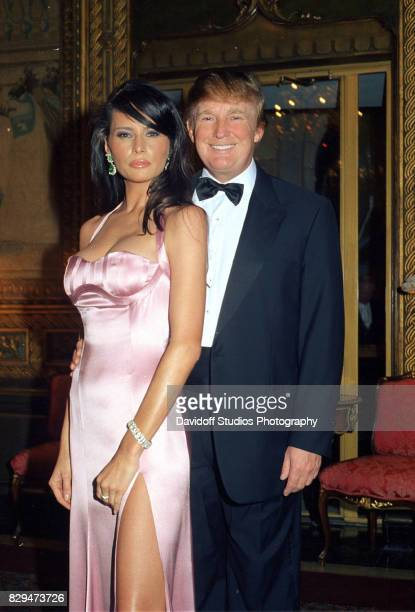 Portrait of model Melania Knauss and real estate developer Donald Trump as they pose together during a New Year's Eve party at the MaraLago estate...