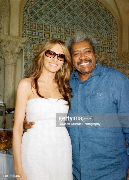 Portrait of model Melania Trump and boxing promoter Don King as they pose together during a brunch at the MaraLago estate Palm Beach Florida January...