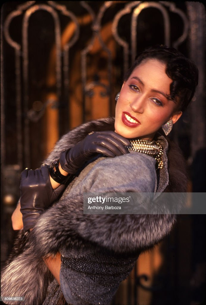 Portrait of model Pat Cleveland, dressed in a fur lined coat, leather gloves, and gold jewelry, New York, 1980s.