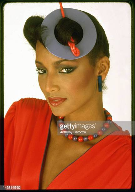 Portrait of model Sheila Johnson as she poses in red against a white background 1979 The picture was part of a photo shoot for Essence magazine