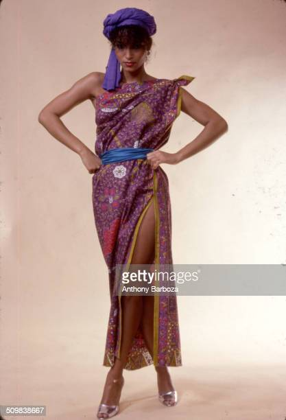 Portrait of model Sheila Johnson dressed in a print dress with purple and blue fabric accents New York 1970s