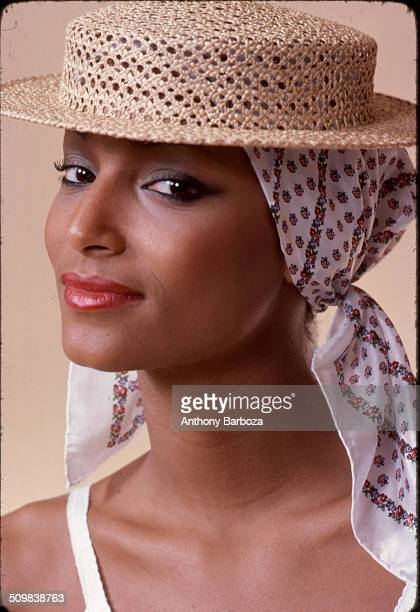 Portrait of model Sheila Johnson dressed in straw hat New York 1970s