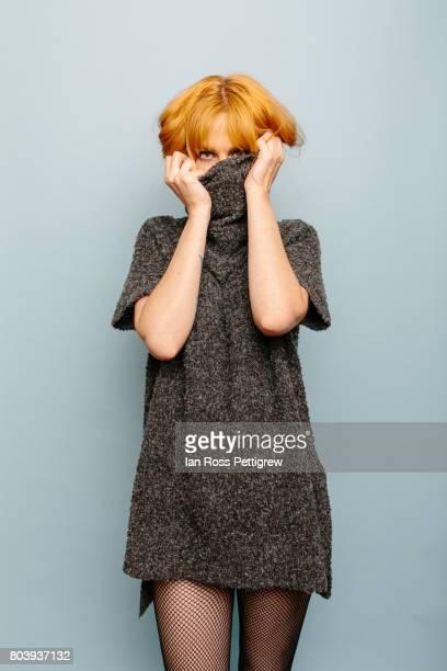 portrait of model wearing turtleneck sweater - coltrui stockfoto's en -beelden