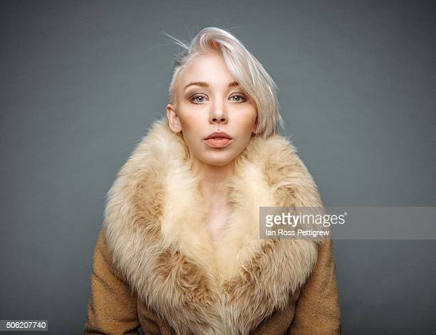 Portrait of model with blonde hair in fur coat