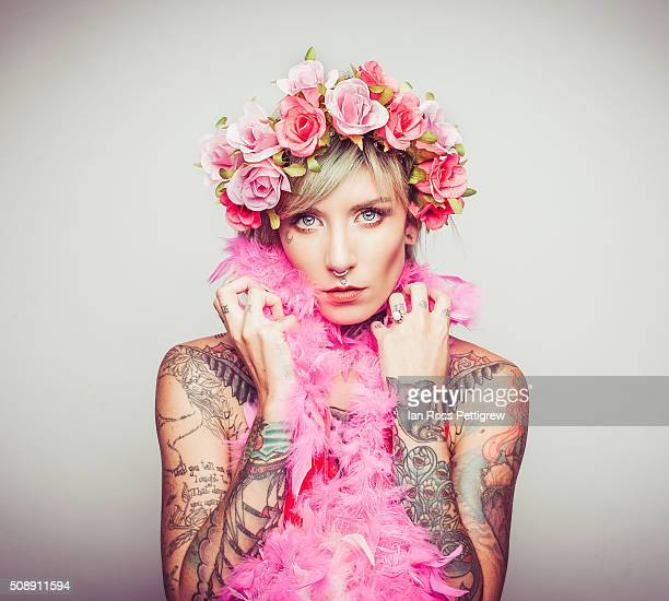 Portrait of model with tattoos and rose crown