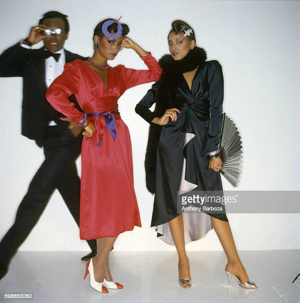 Portrait of models Sheila Johnson and Gay Thomas as they pose against a white background during a studio session New York New York 1980s Male model...