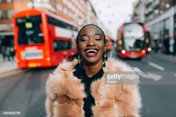 portrait of modern black woman in oxford street in london, uk - oxford street london stock pictures, royalty-free photos & images