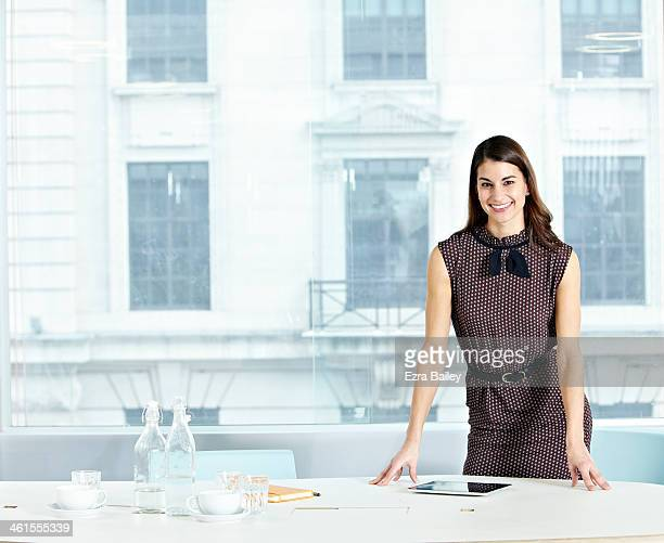 Portrait of modern business woman in white office.
