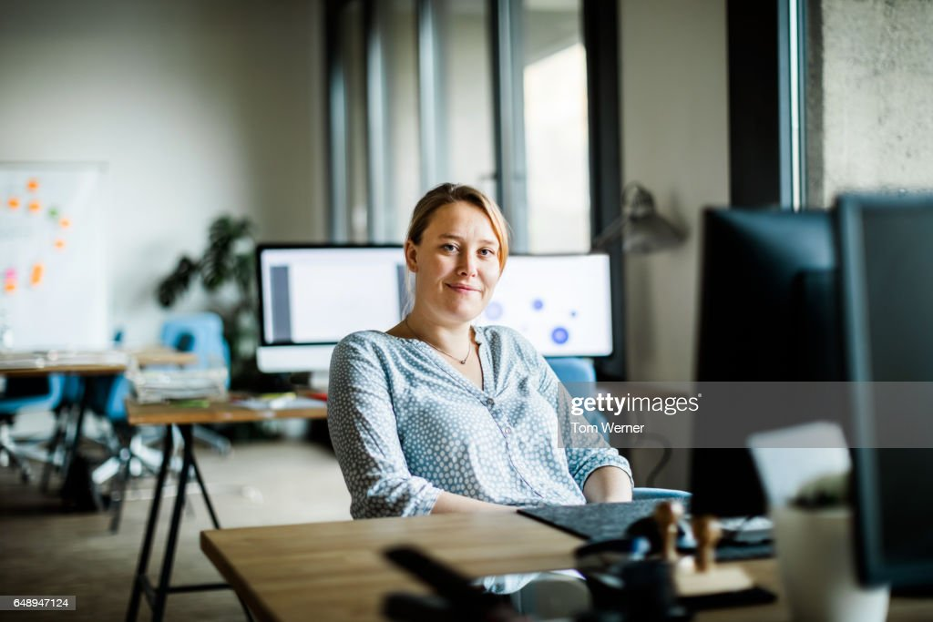 Portrait of modern businesswoman in her office : Stock Photo