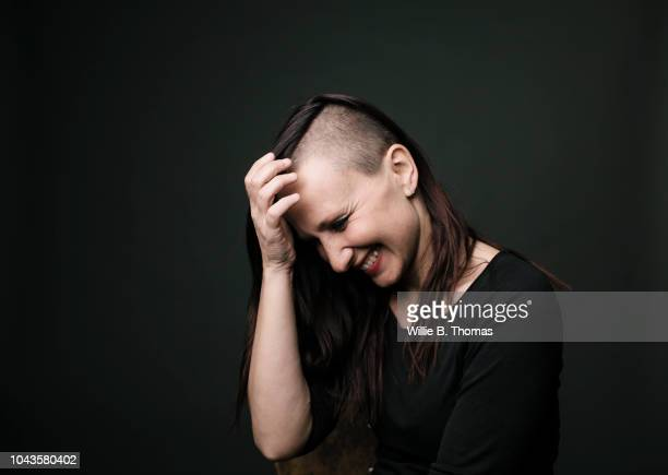 portrait of modren young woman - half shaved hairstyle stock pictures, royalty-free photos & images