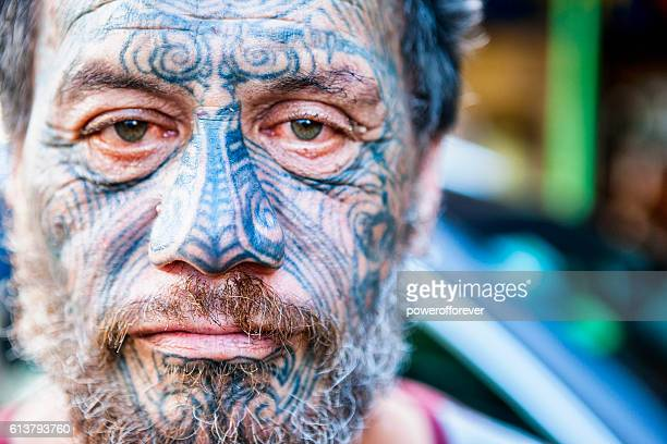 Portrait of Māori man with traditional Tā moko face tattoos