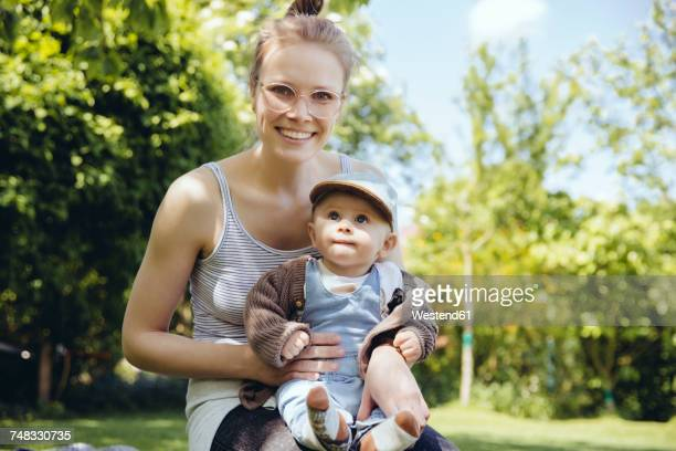 Portrait of mother and baby boy in the garden