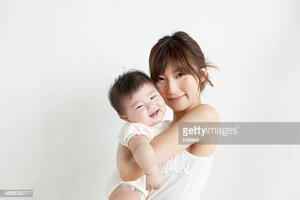 portrait of mother and baby boy - asian baby stockfoto's en -beelden