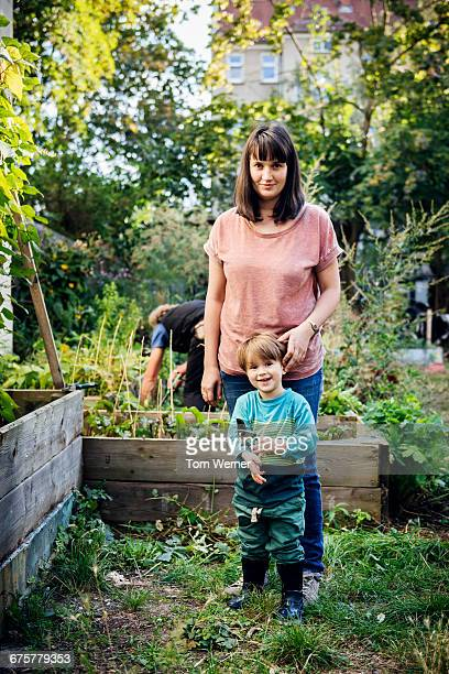 Portrait of mother and child in community garden