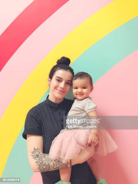 Portrait Of Mother And Daughter Against Multi Colored Background