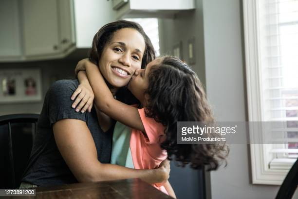 portrait of mother and daughter at home in kitchen - mother stock pictures, royalty-free photos & images