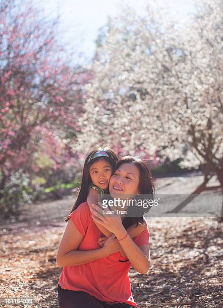 portrait of mother and daughter at the park