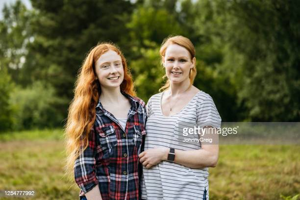 portrait of mother and daughter embracing on weekend hike - mother stock pictures, royalty-free photos & images