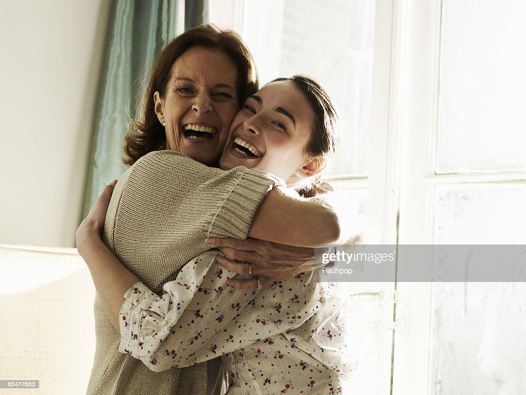 Portrait of mother and daughter embracing : Photo