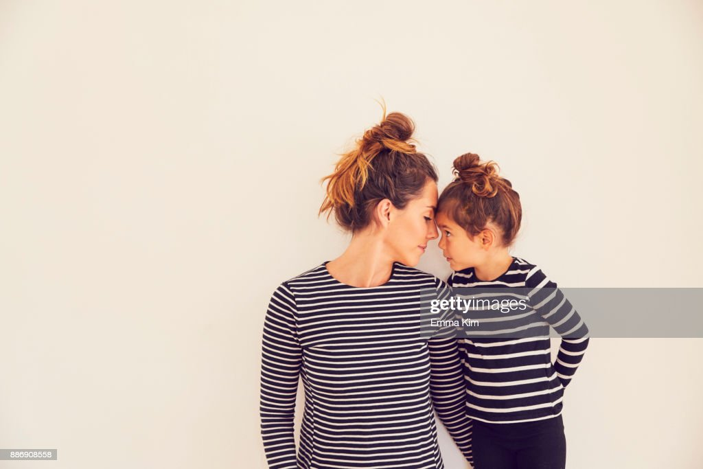 Portrait of mother and daughter, face to face : Stock Photo