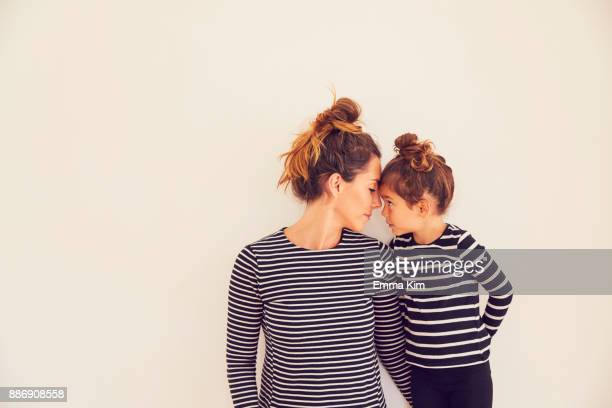 portrait of mother and daughter, face to face - mother daughter stock photos and pictures