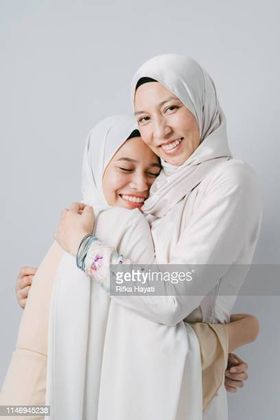 portrait of mother and daughter for eid mubarak - eid al adha stock pictures, royalty-free photos & images