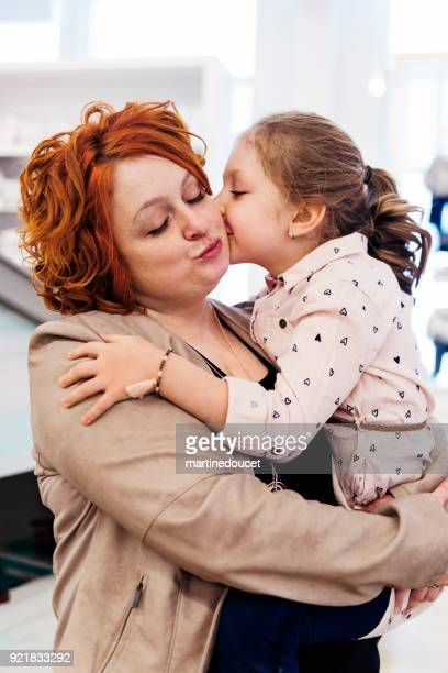 "portrait of mother and daughter in a children store. - ""martine doucet"" or martinedoucet stock pictures, royalty-free photos & images"
