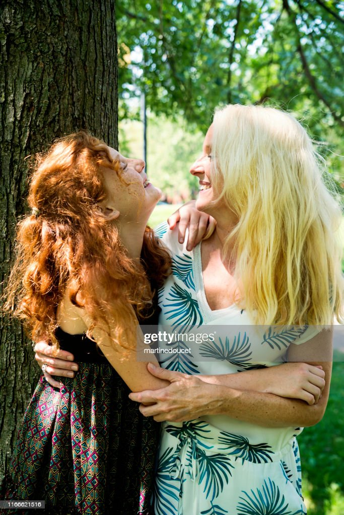 Portrait of mother and daughter in a park. : Stock Photo
