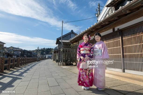 portrait of mother and daughter in traditional city on coming of age day - seijin no hi stock pictures, royalty-free photos & images