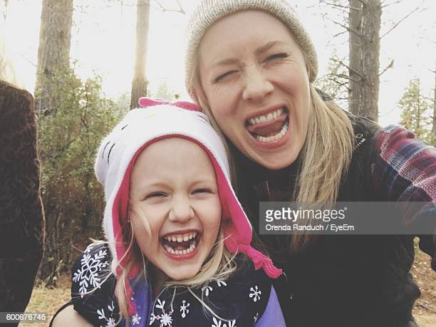 Portrait Of Mother And Daughter Laughing