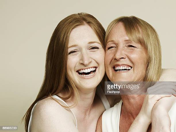 portrait of mother and daughter laughing - daughter stock pictures, royalty-free photos & images