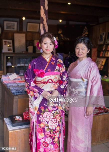 portrait of mother and daughter on coming of age day - seijin no hi stock pictures, royalty-free photos & images