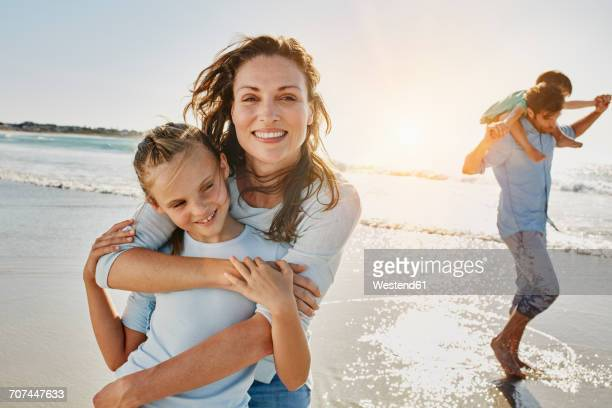 Portrait of mother and daughter on the beach