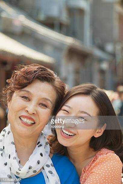 Portrait of mother and daughter on the street in Beijing, close up