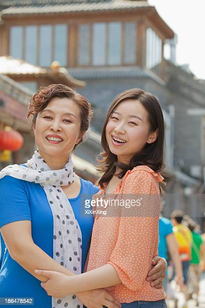 Portrait of mother and daughter on the street in Beijing