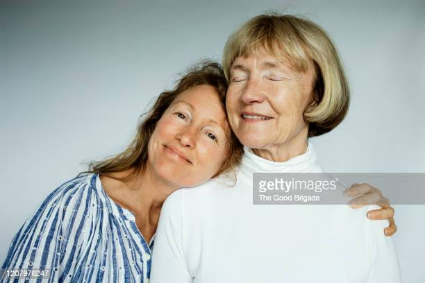 portrait of mother and daughter on white background - daughter stock pictures, royalty-free photos & images