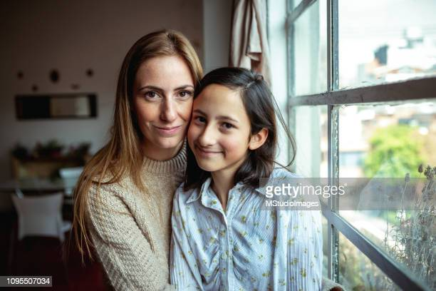 portrait of mother and daughter. - single mother stock pictures, royalty-free photos & images