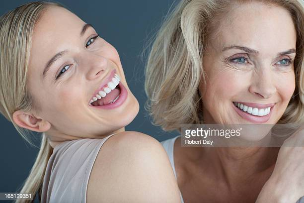 portrait of mother and daughter - cheek stock pictures, royalty-free photos & images