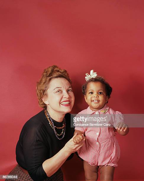 portrait of mother and daughter - black ginger baby stock photos and pictures
