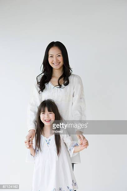 portrait of mother and daughter (8-9) - japanese mom stock photos and pictures