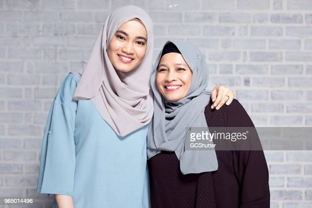 portrait of mother and daughter - malay stock photos and pictures
