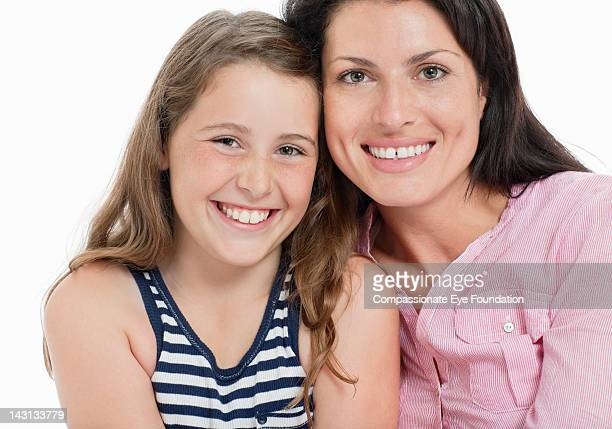 """portrait of mother and daughter, smiling, close up - """"compassionate eye"""" foto e immagini stock"""