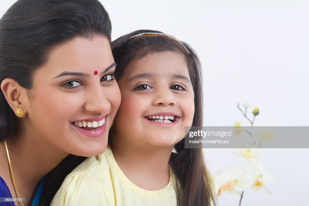 Portrait of mother and daughter smiling : Stock Photo